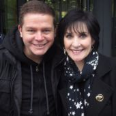 Enya with a fan in frot of the BBC Radio building in London