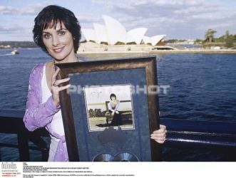 Holding an award for A Day without Rain, Sidney
