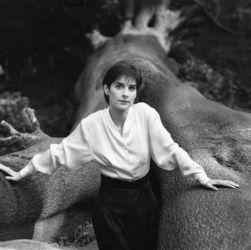 Enya photographed in Hampstead Heath, London in 1987 by Sheila Rock