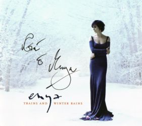Promotional UK single of Trains and Winter Rains. This copy was a prize in the 2008 Loxian Games, that's why the cover is signed.. Photo by Simon Fowler. Scanned by enya.sk.